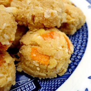 Small kumquat and coconut cookies on a plate